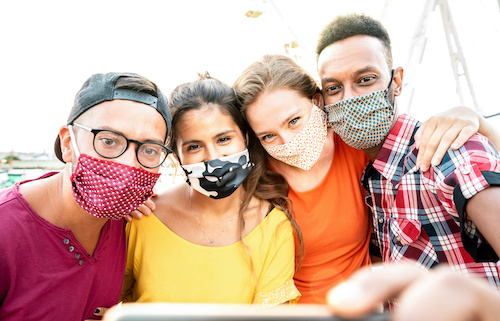 group of diverse teens wearing masks
