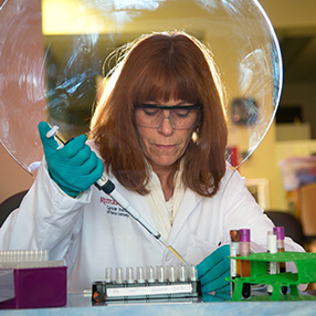 Female researcher working in the lab at Rutgers Cancer Institute